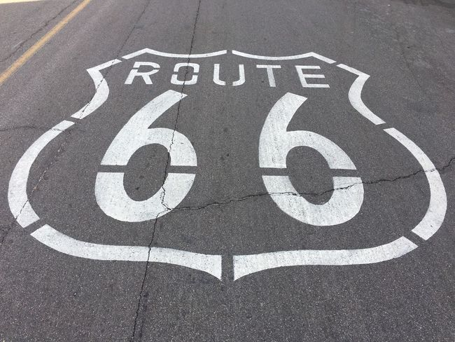 Route 66 pavement markings in Needles, California Road Road Marking Street Asphalt Communication White Color High Angle View Day No People Outdoors Road Sign Route 66 Historic Route 66 California Needles CA Mother Road