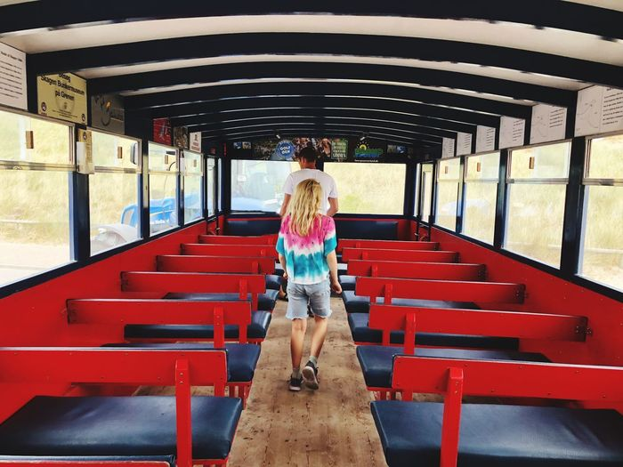 Bus Transportation Red Seats Bus One Person Full Length Front View Lifestyles Real People Casual Clothing Transportation Child