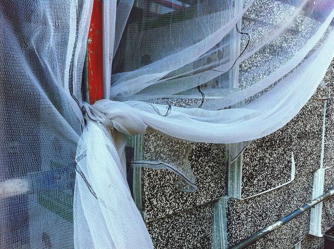 gauze wrapped around scaffolding Gauze wrapped Scaffolding construction site Tiles