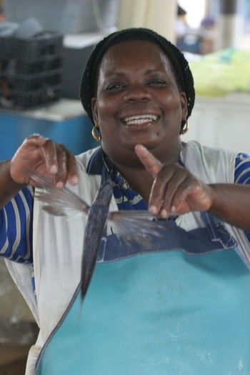 Barbados Caribbean Sea Cheerful Enjoyment Fish Market Fresh Fish Front View Happiness Lifestyles One Person Portrait Real People Smiling
