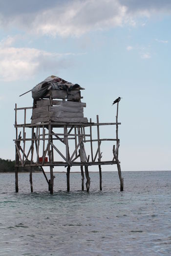 Pelican Bar in Parottee Bay (Jamaica) Caribbean Sea Parotte Bay, Jamaica Parottee Bay Pelican Bar Bar On Stilts House On Water Hut On Water Jamaica Tourism