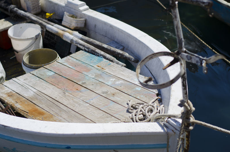 High angle view of fishing boat moored at harbor