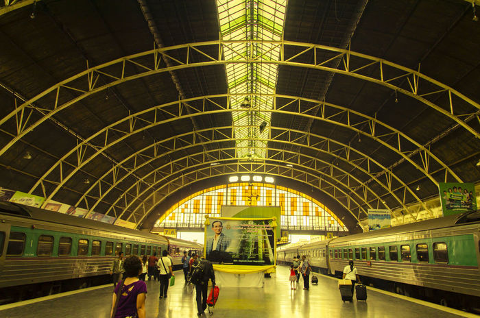 Bangkok Railway Station Arch Architecture Built Structure City Life Group Of People Hua Lamphong Hua Lamphong Railway Station, Bangkok, Thailand Illuminated Large Group Of People Leisure Activity Lifestyles Medium Group Of People Mixed Age Range Modern Public Transportation Subway Station The King The KING Of Thailand Tourism Tourist Transportation Transportation Building - Type Of Building Travel Destinations