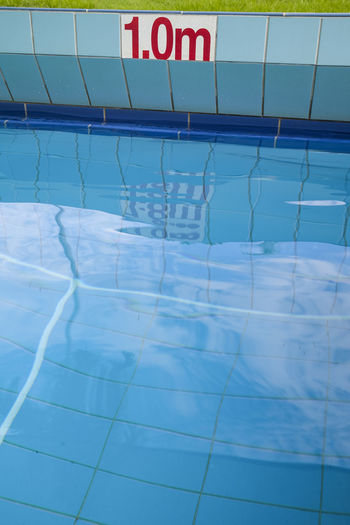 Reflection of text on water in swimming pool