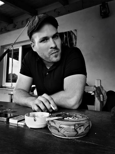 Portrait mid adult man sitting on restaurant table