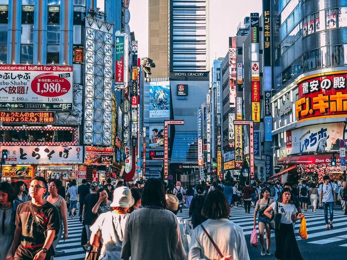 Tokyo City Group Of People Built Structure Real People Architecture Men Building Exterior Communication Leisure Activity Text Crowd Street City Life Women Adult Large Group Of People Lifestyles Walking Advertisement