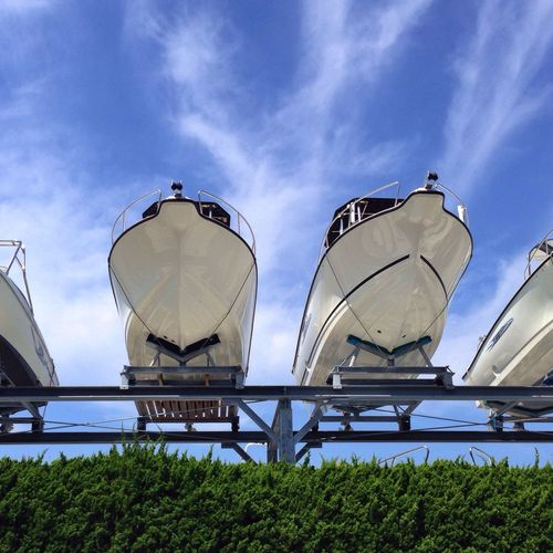Low angle view of yachts on rack