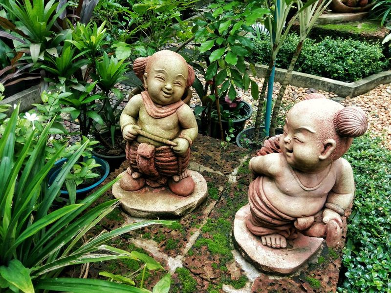 Sculpture Outdoors Day Plant Garden Decor Art And Craft Nature No People Green Color Happiness Male Likeness Statue Clay Dolls
