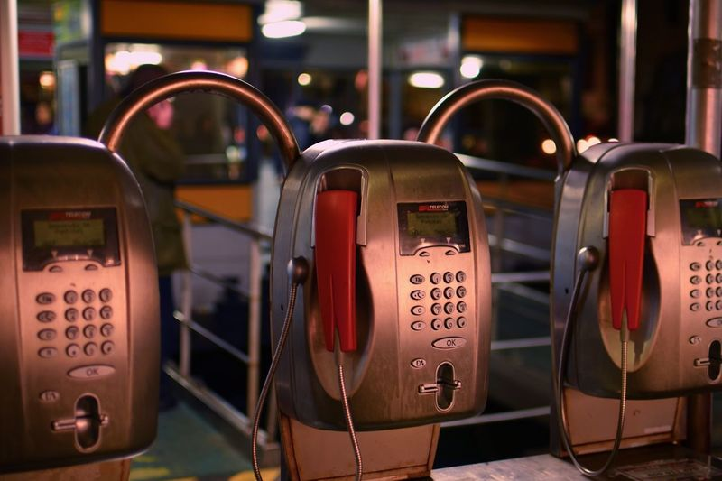 Close-up of pay phones in city at night