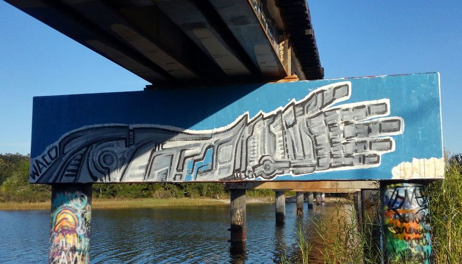 Graffiti Bridge EyeEm Selects Graffiti Built Structure Architecture Street Art Day Water Outdoors Blue No People Building Exterior Sea City Sky Rethink Things Pensacola Florida 17thAveDesigns Robot Hand Street Art Photography Street Art/Graffiti No Edit/no Filter