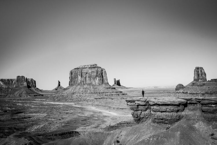 Person on outcropping overlooking Monument Valley, Arizona Lonely Road To Nowhere Solitary Beauty In Nature Black And White Photography Clear Sky Day Depression - Sadness Grandure Landscape Nature Outcropping Outdoors Person Walking Physical Geography Rock - Object Rock Formation Scenics Sky Solitary Moments Solitude Tiny Feeling Tranquil Scene Tranquility Travel Destinations Water The Great Outdoors - 2018 EyeEm Awards The Traveler - 2018 EyeEm Awards