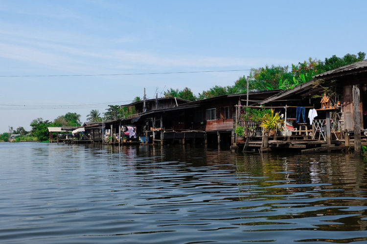 Thai Local Thailand Photos Stilt House Water Tropical Climate Floating On Water Building Exterior Tourism Outdoors Vacations Travel Destinations Nautical Vessel Architecture Travel Lake Cloud - Sky Sky Nature No People Day