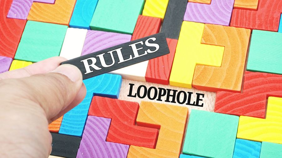 Loophole in the set of rules Jigsaw  Puzzle  Brick Wooden Loophole Set Rules Laws Lawmakers System Information Technology Concept Message Alphabet ABC Board Words Strategy Strategic Planning Strategic Management Decisions One Man Only One Person Vibrant Color Communication Choosing Indoors  Color Swatch