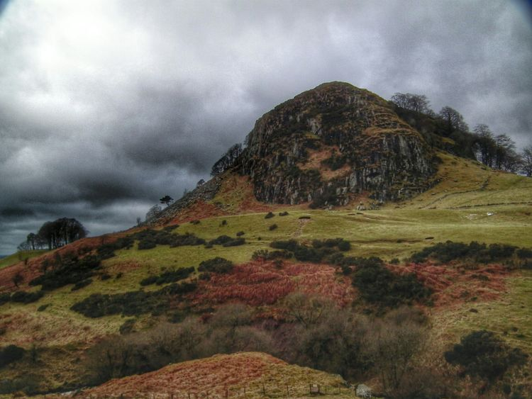 Loudoun Hill on a dreary day. An ancient volcanic plug, it had been lived on for thousands of years. A beautiful area situated in Ayrshire not far from Strathaven and Muirkirk. The scene of many a battle, both Bruce and Wallace fought here. Just along the road is Drumclog. Taking Photos Hill Walking Scotland Countryside