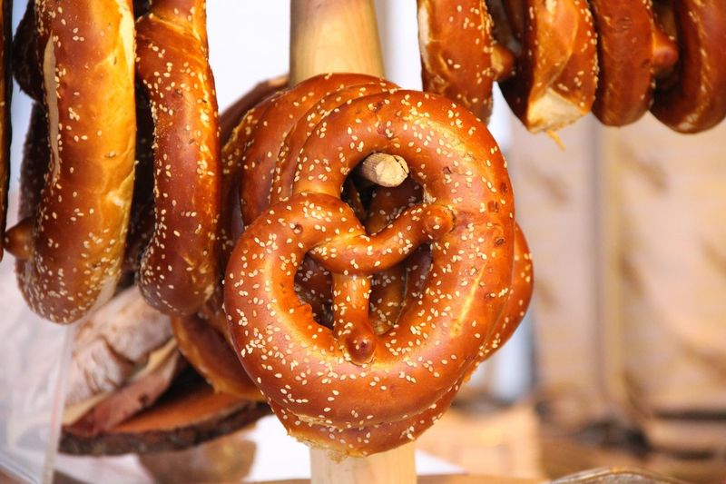 Bavarian pretzel in Munich Bavaria Bavarian Tradition Bavarian Food Traditional Bavarian Food Food Food And Drink Freshness Pretzel Baked Indulgence Snack Unhealthy Eating Close-up Ready-to-eat Sweet Food No People Focus On Foreground Bread Still Life Concession Stand Christmas Market Bakery Salted