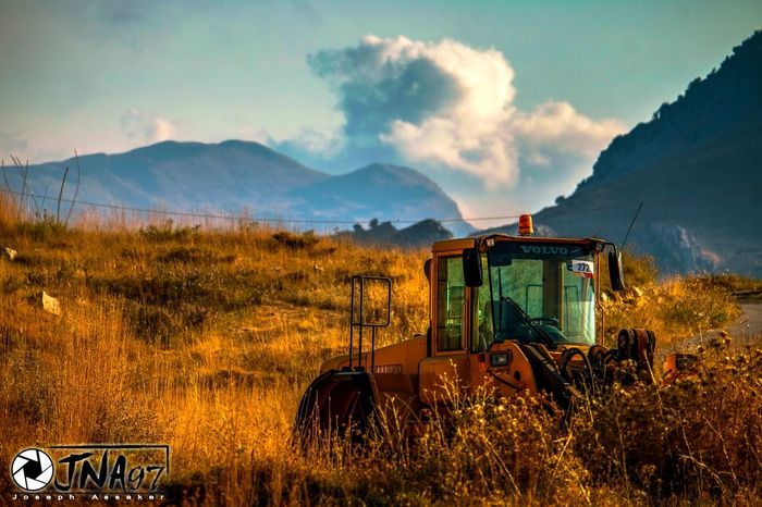 Working in the mountains where peace of mind dominates, is one of the best dream jobs in the world. But you should always keep your respect for the nature, cause there's a slight line between working for a living and destroying the nature. Hope laklouk keeps it's respect for this beautiful nature.. 🚜🏔☁ Mountain Mountain Range Cloud - Sky Dramatic Sky No People Sky Outdoors Nature Day Light Truck Peace Life Quotes Laklouk Lebanon Mountains Clouds Tranquil Scene Wheat Wheat Field Village Village Life