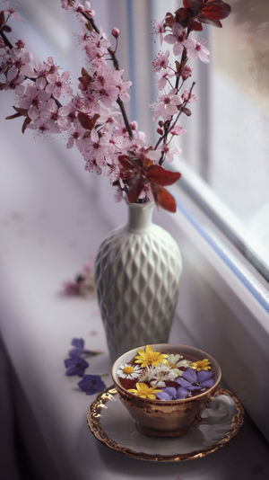 Close-up of cherry blossom in vase on table