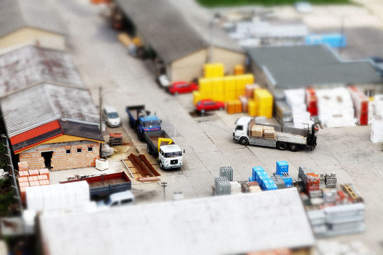 Tilt-Shift Image Of Trucks At Factory