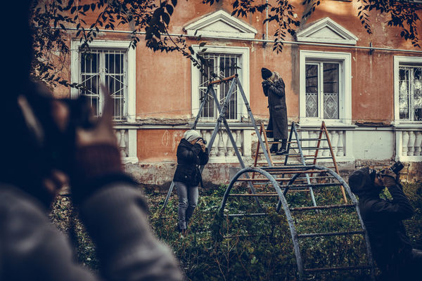 Architecture Building Exterior Built Structure Camera - Photographic Equipment Day Human Hand Men One Person Outdoors People Photographing Photography Themes Real People Window