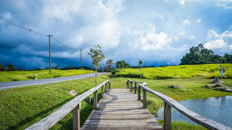 Beauty In Nature Blue Cloud Cloud - Sky Day Diminishing Perspective Field Grass Grassy Green Green Color Growth Landscape Long Narrow Nature Outdoors Plant Railing Scenics Sky The Way Forward Tranquil Scene Tranquility Water 100 Days Of Summer