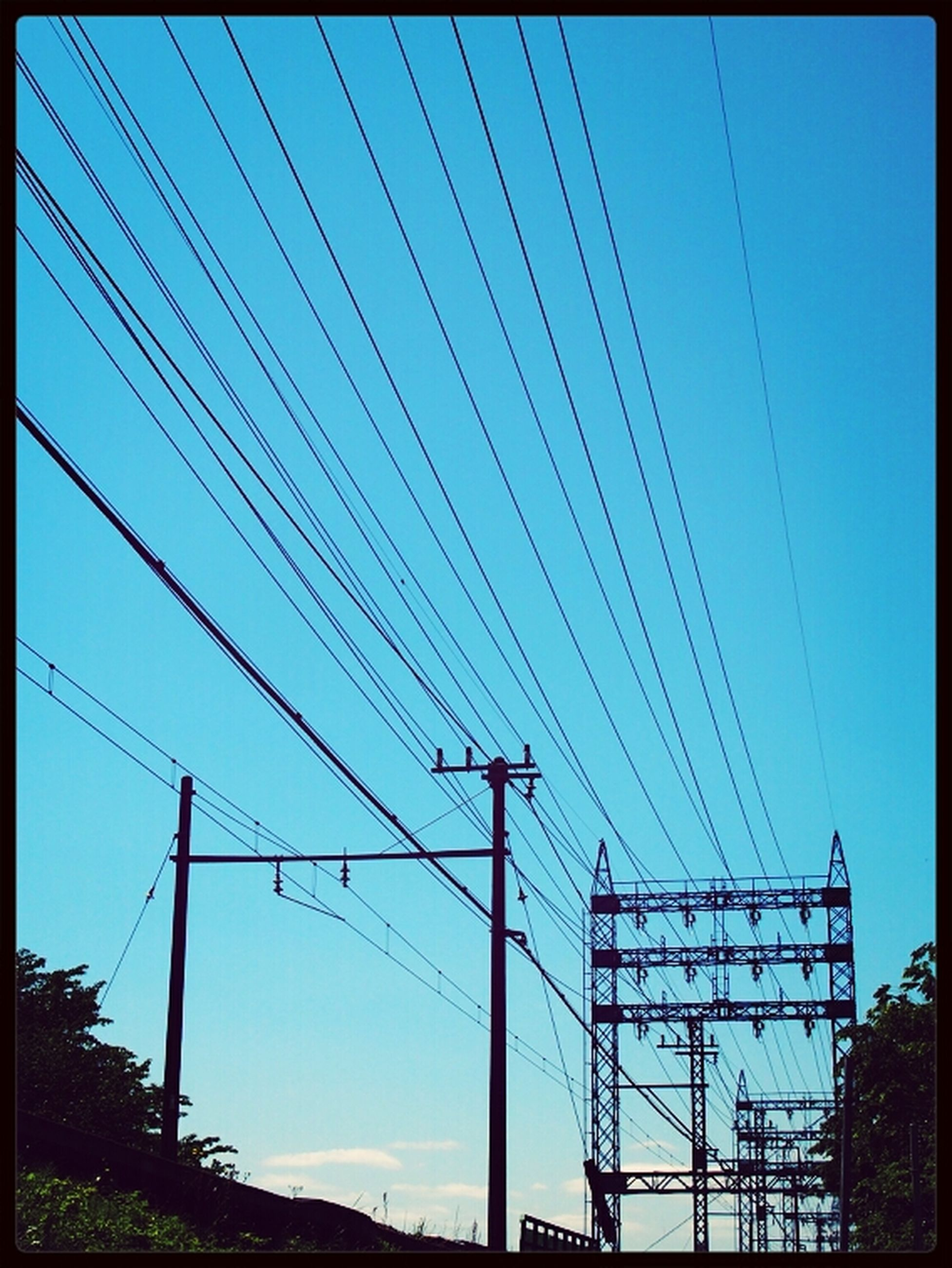 power line, electricity pylon, power supply, electricity, connection, fuel and power generation, low angle view, cable, technology, power cable, transfer print, clear sky, sky, blue, auto post production filter, electricity tower, outdoors, day, silhouette, no people