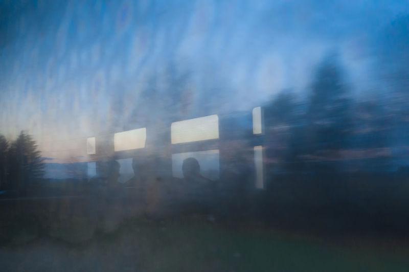 Defocused image of building against sky