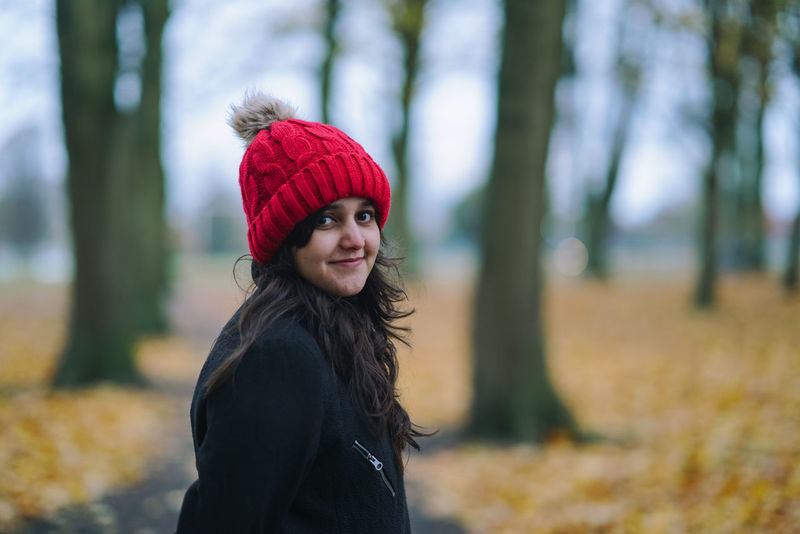 Autumn Beautiful People Beauty Beauty In Nature Cheerful Fashion Knit Hat One Woman Only Portrait Red Hat Relax Season  Smiling Tree Uk Warm Clothing Winter Women Young Adult