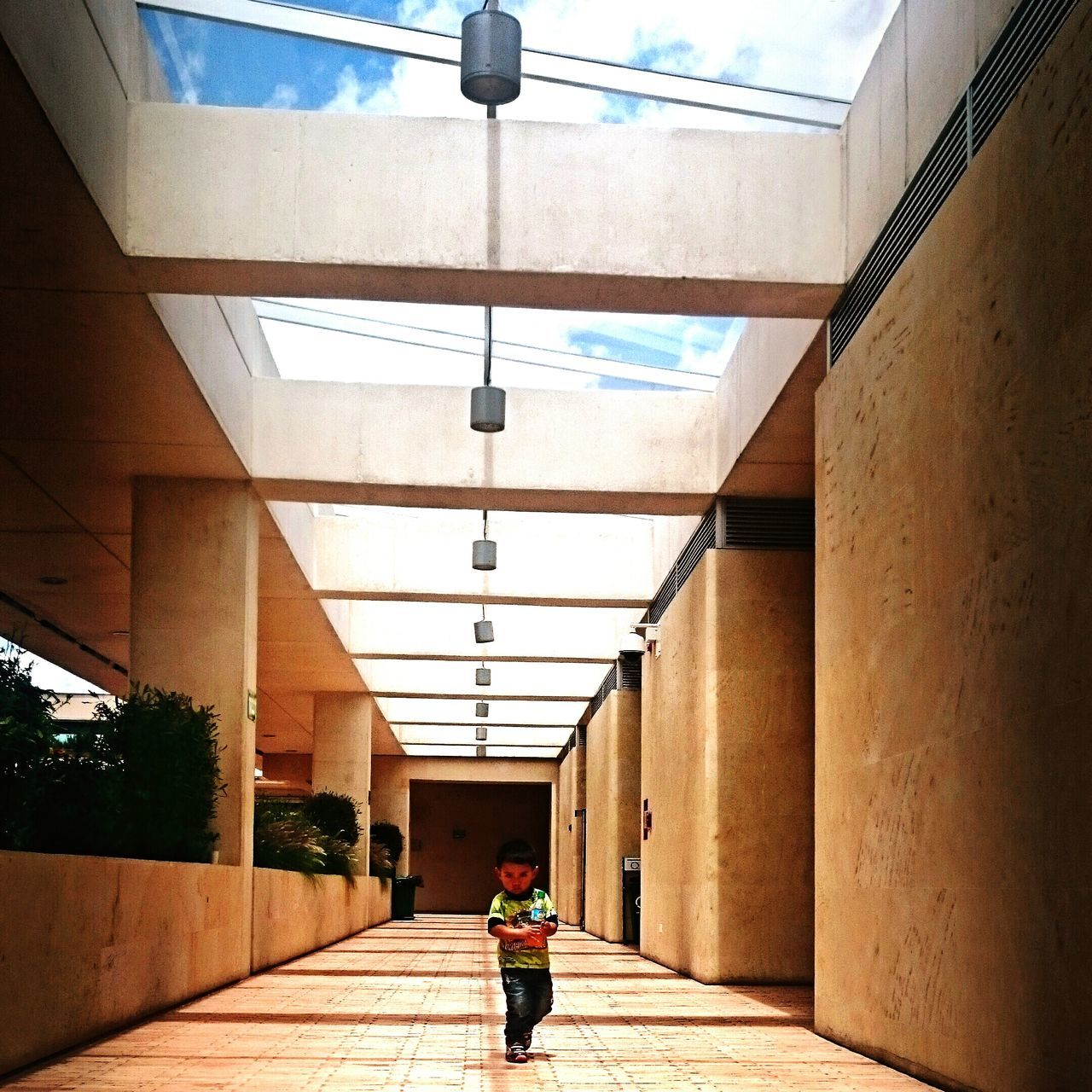 walking, rear view, architecture, one person, real people, built structure, the way forward, full length, day, indoors, women, walkway, people