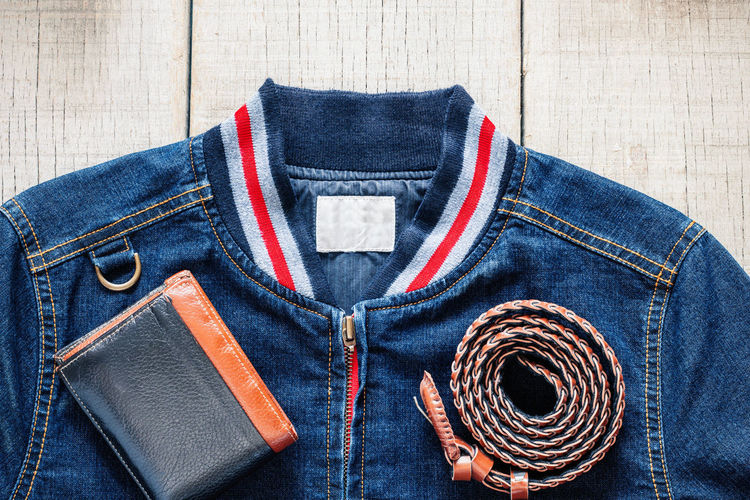 Belt  Blue Casual Clothing Close-up Clothing Denim Directly Above Fashion Indoors  Jacket Jeans Leather Material People Personal Accessory Pocket  Still Life Textile Top - Garment Wood - Material