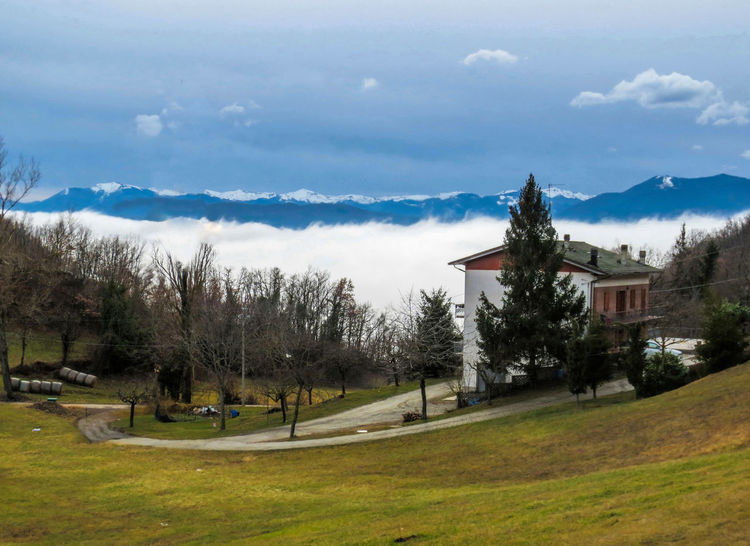 Fog in Emilia Romagna Cloud Architecture Bare Tree Beauty In Nature Building Exterior Built Structure Cloud - Sky Clouds And Sky Day Emiliaromagna Fog Grass Growth Landscape Mountain Mountain Range Nature No People Outdoors Scenics Sky Tranquil Scene Tranquility Travel Destinations Tree