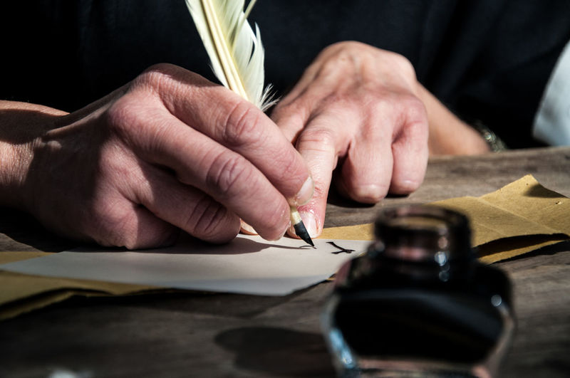Close-Up Of Hand Writing A Letter