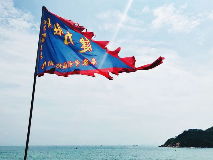 Temple flag in the sea breeze Buddhism Temple View Sea HongKong Travel Destinations Sky Flag Cloud - Sky Nature Water No People Low Angle View Wind Day Environment Outdoors Sea Shape Scenics - Nature