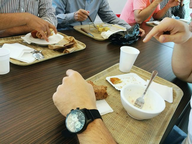 ShareTheMeal Food And Drink Men Table Person Lifestyles Sitting High Angle View Food Indoors  Togetherness Friendship Meal Personal Perspective Sitting Eating Ready-to-eat Enjoy The New Normal
