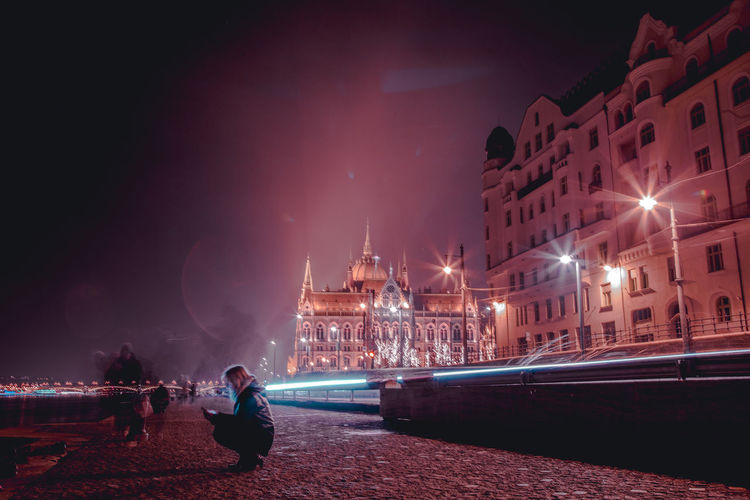 someone familiar Cityscape City At Night River Bank  Danube River Danube Long Exposure City Lights Cityscape City Life City Illuminated Water Cityscape Red Sky The Traveler - 2018 EyeEm Awards