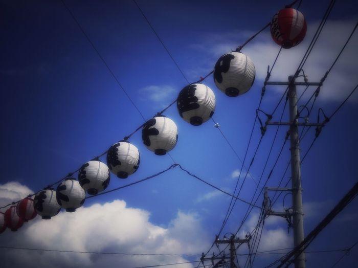 Paper Lanterns Against Blue Sky