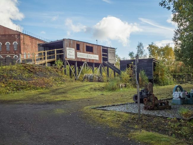 Coal Mine Museum Mining Wooden Structure No People Pit Industrial Victorian History Red Brick Wooden Hut Steel Structure  Coal Mine Scottish Wheels Machines Day Outside Horizontal Historical Building Industry Walkway Trees Path