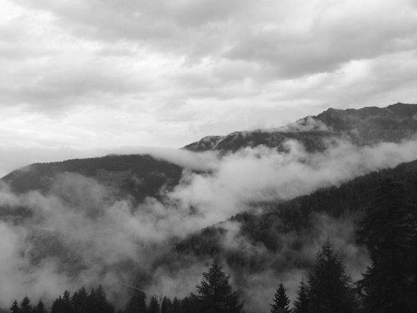 Atmosphere Monochrome Photography Beauty In Nature Blackandwhite Cloud - Sky Cloudscape Covering Day Dreamlike Environment Fog Foggy High Up Idyllic Majestic Mountain Mountain Range Nature Remote Scenics Sky Tourism Tranquil Scene Tranquility Travel Destinations