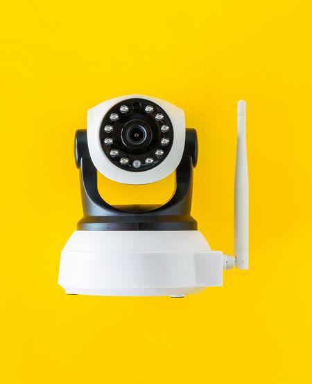 CCTV on yellow background Camera Security View Black Color Cctv Closed Circuit Camera Colored Background Communication Cut Out Equipment Evidence Indoors  Investigate Overseer Prevent Previous Record Single Object Studio Shot Technology The Past Yellow Yellow Background