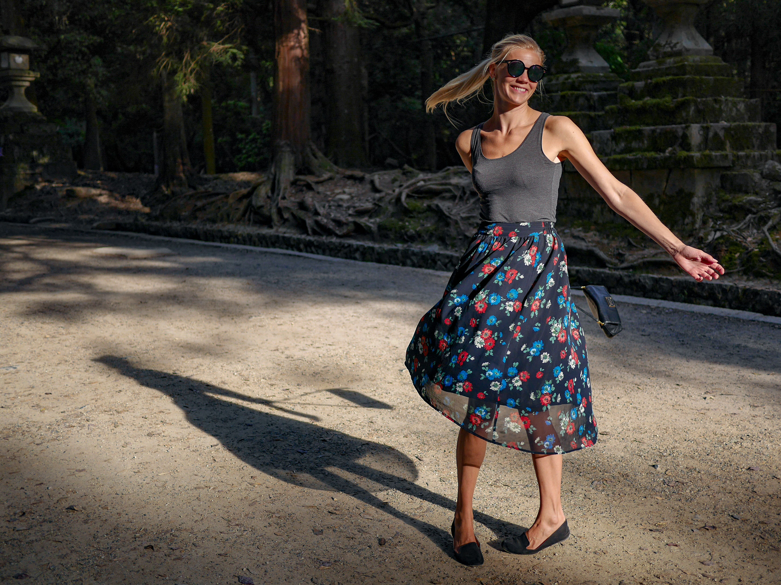sunglasses, dress, full length, fashion, only women, smiling, adult, one person, looking at camera, portrait, beautiful woman, one woman only, sunlight, shadow, adults only, women, fashion model, happiness, standing, outdoors, beauty, day, people, tree, young adult, one young woman only, young women