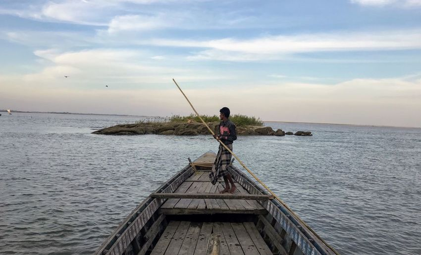 Sky Water One Person Sea Cloud - Sky Fishing Horizon Over Water Nature Real People Full Length Outdoors Standing Beauty In Nature Tranquil Scene Day Scenics Fishing Pole Tranquility Men Adult Perspectives On Nature