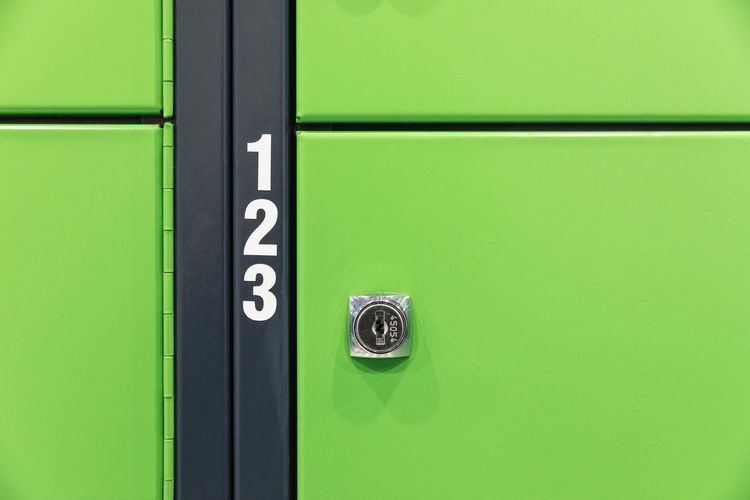 Close-up of numbers on green locker