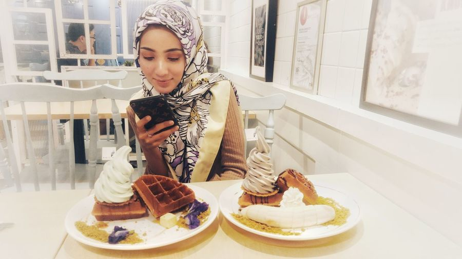 Young women taking picture of a food Foodie Food Dessert Foodie Scene Lady Pretty Beautiful White Ice Cream Young Women Women Bakery Window Cake Occupation Sweet Food Dessert Pastry Waffle Ice Cream Parlor Served The Fashion Photographer - 2018 EyeEm Awards EyeEmNewHere