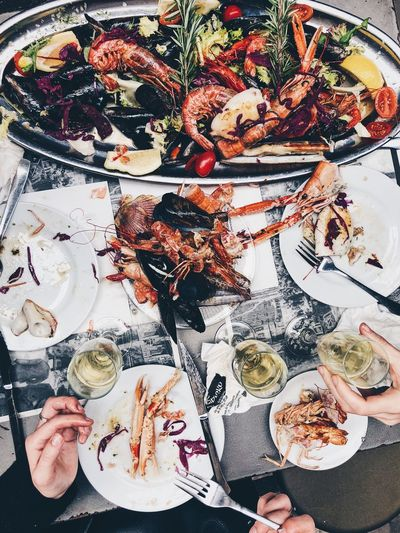 Seafood Platter Food And Drink Food Seafood Freshness Plate Healthy Eating Wellbeing High Angle View Ready-to-eat Crustacean Directly Above Table Real People Human Hand Serving Size Meat Human Body Part Hand Kitchen Utensil Meal Finger Prawn Shrimp Mussles