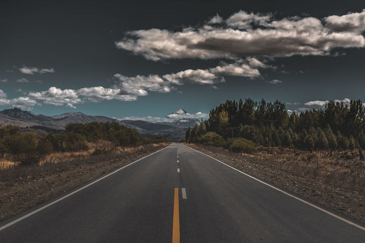 Road Sky Road Marking Direction Transportation Symbol Sign The Way Forward Cloud - Sky Marking No People Tree Diminishing Perspective Nature Tranquil Scene Tranquility Scenics - Nature Non-urban Scene Plant Environment Outdoors Dividing Line Long Surface Level