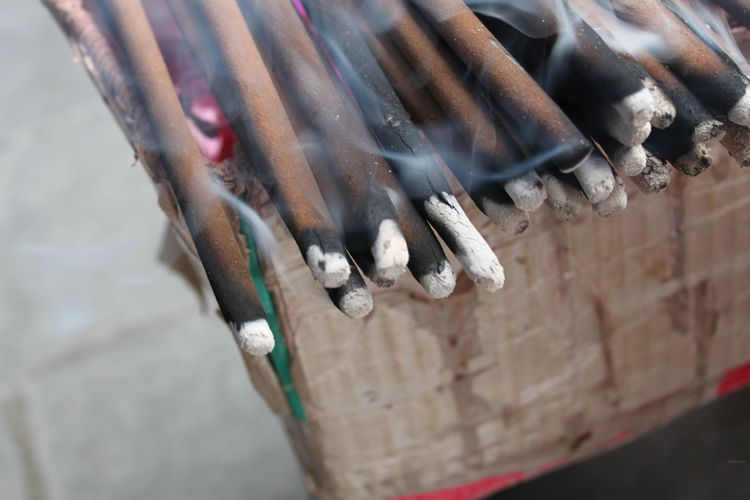 Close-up of lit incense sticks at temple