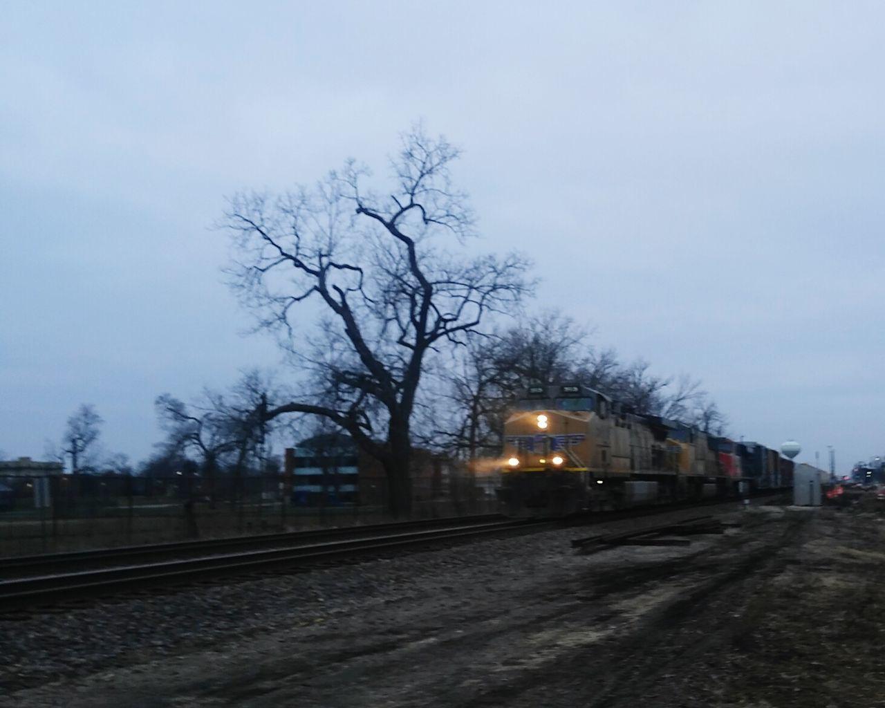 transportation, railroad track, rail transportation, public transportation, train - vehicle, mode of transport, sky, travel, outdoors, no people, tree, nature, illuminated, day