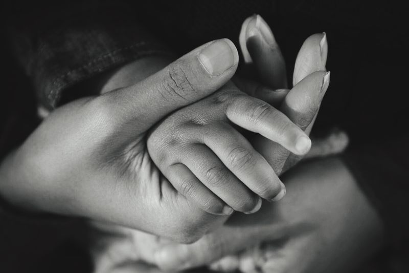 Tender touch Monochrome Tender Baby Love Maternity Motherhood Human Hand Hand Human Body Part Human Finger Finger Body Part Close-up Real People Holding Unrecognizable Person Emotion Selective Focus Human Connection