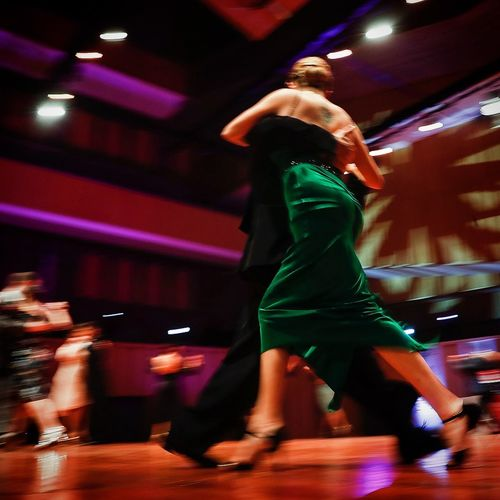 Adult Arts Culture And Entertainment Blurred Motion Dancing Full Length Illuminated Incidental People Indoors  Leisure Activity Lifestyles Light Men Motion Night Nightclub Nightlife People Real People Side View Sport