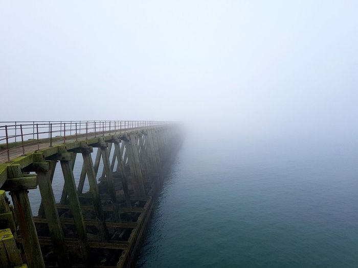 Misty pier, Blyth, Northumberland Sea Mist Northumberland Coastline Blyth Misty Landscape Pier Ocean View Seascape Seascape Photography Moody Weather Wooden Pier Man Made Structure Fog Sky Ocean Calm Sea Jetty