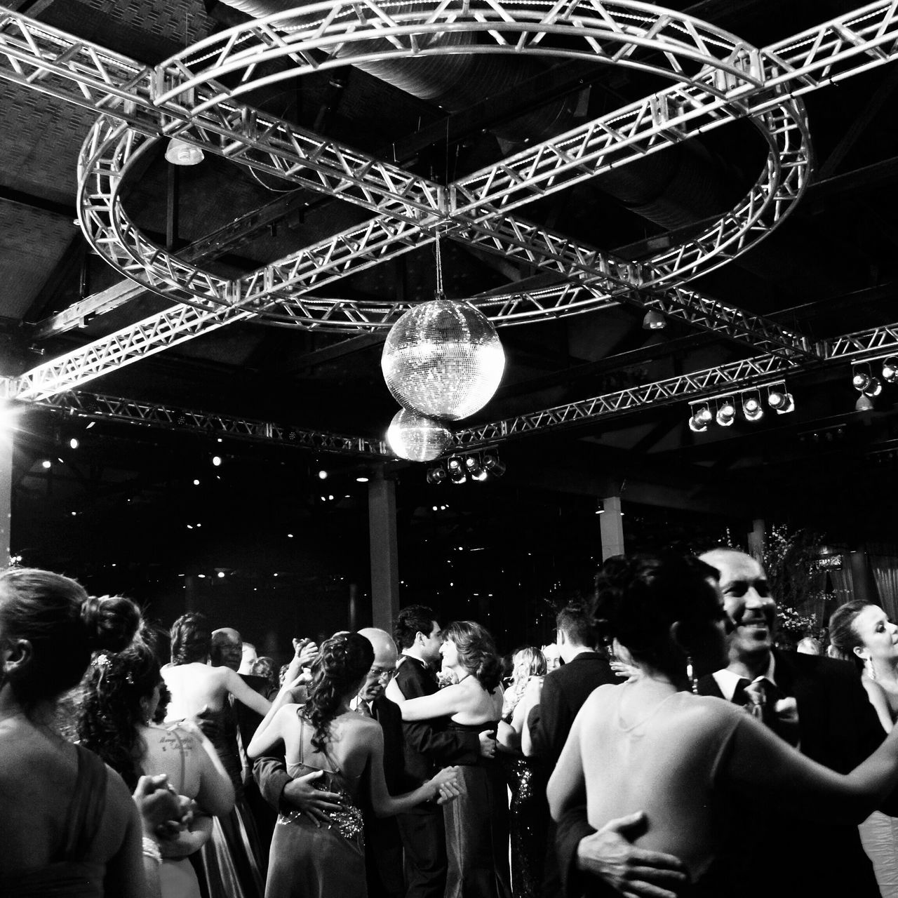 large group of people, celebration, lighting equipment, indoors, crowd, men, illuminated, leisure activity, enjoyment, arts culture and entertainment, women, nightclub, night, party - social event, people, adult
